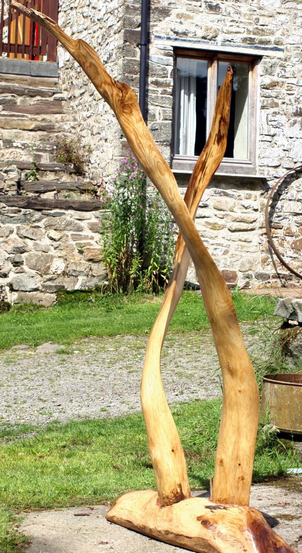 Wooden garden sculptures